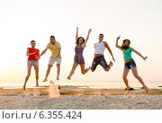 Купить «smiling friends dancing and jumping on beach», фото № 6355424, снято 3 августа 2014 г. (c) Syda Productions / Фотобанк Лори