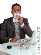 Купить «A con man smelling his loot», фото № 6355972, снято 19 мая 2011 г. (c) Phovoir Images / Фотобанк Лори