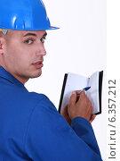 Купить «Craftsman holding an agenda», фото № 6357212, снято 9 июня 2011 г. (c) Phovoir Images / Фотобанк Лори
