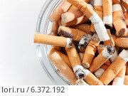 Купить «Overhead view of glass ashtray full of cigarette stubs», фото № 6372192, снято 12 декабря 2018 г. (c) Ingram Publishing / Фотобанк Лори