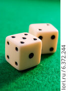 Купить «Pair of dice on a green baize surface», фото № 6372244, снято 23 октября 2018 г. (c) Ingram Publishing / Фотобанк Лори