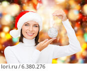 Купить «woman in santa helper hat with christmas ball», фото № 6380276, снято 15 августа 2013 г. (c) Syda Productions / Фотобанк Лори