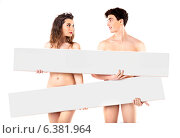 Nude attractive young couple with empty boards. Стоковое фото, агентство Ingram Publishing / Фотобанк Лори