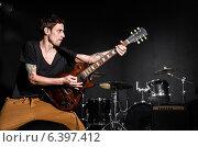 Купить «Man with guitar during concert», фото № 6397412, снято 18 февраля 2013 г. (c) Elnur / Фотобанк Лори