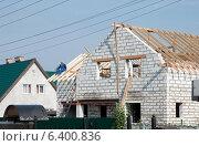 Купить «Строительство нового дома», эксклюзивное фото № 6400836, снято 13 сентября 2014 г. (c) Svet / Фотобанк Лори