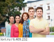 Купить «group of smiling teenagers over campus background», фото № 6409232, снято 22 июня 2014 г. (c) Syda Productions / Фотобанк Лори