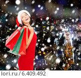 Купить «woman in red dress with shopping bags», фото № 6409492, снято 15 августа 2013 г. (c) Syda Productions / Фотобанк Лори