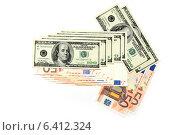 Купить «Стрелка из купюр евро и долларов на белом фоне», фото № 6412324, снято 15 ноября 2012 г. (c) Андрей Бурдюков / Фотобанк Лори