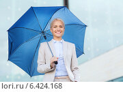 Купить «young smiling businesswoman with umbrella outdoors», фото № 6424168, снято 19 августа 2014 г. (c) Syda Productions / Фотобанк Лори