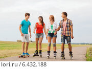 Купить «Group of smiling teenagers with roller-skates», фото № 6432188, снято 10 августа 2014 г. (c) Syda Productions / Фотобанк Лори