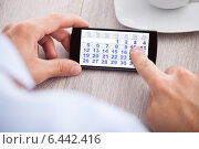 Купить «Businessman Touching Calendar Date On Mobile Phone», фото № 6442416, снято 25 марта 2014 г. (c) Андрей Попов / Фотобанк Лори