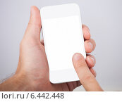 Купить «Hand Holding Smartphone With Blank Screen», фото № 6442448, снято 22 марта 2014 г. (c) Андрей Попов / Фотобанк Лори