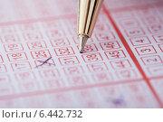 Купить «Pen Marking Numbers On Lottery Ticket», фото № 6442732, снято 18 мая 2014 г. (c) Андрей Попов / Фотобанк Лори