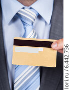 Купить «Businessman Giving Credit Card», фото № 6442736, снято 25 марта 2014 г. (c) Андрей Попов / Фотобанк Лори