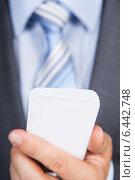 Купить «Businessman Using Smartphone», фото № 6442748, снято 25 марта 2014 г. (c) Андрей Попов / Фотобанк Лори