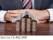 Купить «Businessman With Coins And Banknote House On Desk», фото № 6442908, снято 6 мая 2014 г. (c) Андрей Попов / Фотобанк Лори