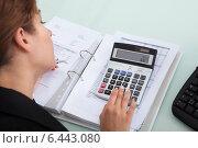Купить «Businesswoman Calculating Bills At Desk», фото № 6443080, снято 18 мая 2014 г. (c) Андрей Попов / Фотобанк Лори