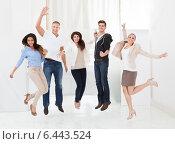 Купить «Confident Businesspeople Jumping With Arms Raised», фото № 6443524, снято 30 марта 2014 г. (c) Андрей Попов / Фотобанк Лори