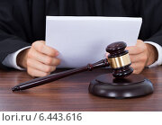Judge Reading Documents At Desk, фото № 6443616, снято 7 мая 2014 г. (c) Андрей Попов / Фотобанк Лори