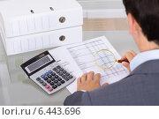 Auditor investigating fraud with magnifying glass. Стоковое фото, фотограф Андрей Попов / Фотобанк Лори