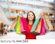 Купить «smiling woman with colorful shopping bags», фото № 6444584, снято 22 сентября 2013 г. (c) Syda Productions / Фотобанк Лори