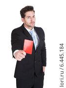 Купить «Handsome Young Businessman Showing Red Card», фото № 6445184, снято 11 мая 2014 г. (c) Андрей Попов / Фотобанк Лори