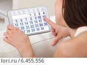 Woman Using Calendar On Digital Tablet At Home. Стоковое фото, фотограф Андрей Попов / Фотобанк Лори