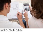 Young couple calculating budget. Стоковое фото, фотограф Андрей Попов / Фотобанк Лори