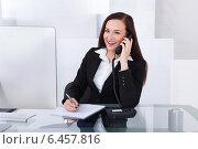 Businesswoman Using Telephone At Desk, фото № 6457816, снято 15 марта 2014 г. (c) Андрей Попов / Фотобанк Лори