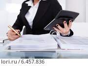 Купить «Accountant Calculating Tax», фото № 6457836, снято 15 марта 2014 г. (c) Андрей Попов / Фотобанк Лори