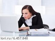 Купить «Businesswoman Using Laptop», фото № 6457848, снято 15 марта 2014 г. (c) Андрей Попов / Фотобанк Лори