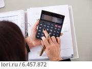 Купить «Accountant Calculating Tax At Desk», фото № 6457872, снято 15 марта 2014 г. (c) Андрей Попов / Фотобанк Лори