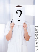 Купить «Doctor Holding Question Mark Sign In Hospital», фото № 6458012, снято 15 марта 2014 г. (c) Андрей Попов / Фотобанк Лори