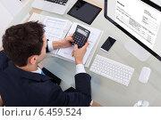 Купить «Businessman Calculating Tax», фото № 6459524, снято 18 января 2014 г. (c) Андрей Попов / Фотобанк Лори