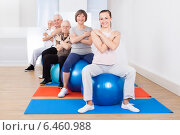 Trainer And Senior Customers Sitting On Fitness Balls. Стоковое фото, фотограф Андрей Попов / Фотобанк Лори