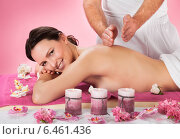 Купить «Woman Receiving Back Massaging In Spa», фото № 6461436, снято 27 апреля 2014 г. (c) Андрей Попов / Фотобанк Лори