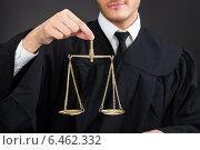 Male Judge Holding Weight Scale. Стоковое фото, фотограф Андрей Попов / Фотобанк Лори