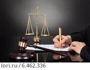 Male Judge Signing Document At Desk. Стоковое фото, фотограф Андрей Попов / Фотобанк Лори