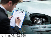 Купить «Insurance Agent Examining Car After Accident», фото № 6462760, снято 28 июня 2014 г. (c) Андрей Попов / Фотобанк Лори