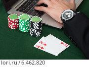 Купить «Businessman Using Laptop By Stacked Poker Chips And Cards», фото № 6462820, снято 28 июня 2014 г. (c) Андрей Попов / Фотобанк Лори