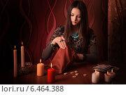 Купить «Young woman with runes and divination cards in room», фото № 6464388, снято 10 января 2014 г. (c) Майя Крученкова / Фотобанк Лори