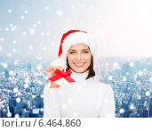 Купить «smiling woman in santa helper hat and jingle bells», фото № 6464860, снято 15 августа 2013 г. (c) Syda Productions / Фотобанк Лори