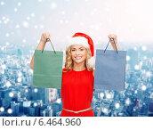 Купить «woman in santa helper hat with shopping bags», фото № 6464960, снято 27 сентября 2013 г. (c) Syda Productions / Фотобанк Лори