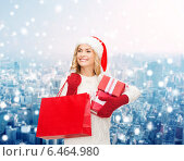 Купить «smiling young woman in santa helper hat with gifts», фото № 6464980, снято 27 сентября 2013 г. (c) Syda Productions / Фотобанк Лори
