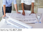 Купить «Two architects looking at blueprints», фото № 6467260, снято 19 февраля 2019 г. (c) Wavebreak Media / Фотобанк Лори