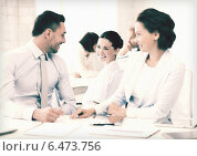 Купить «business team discussing something in office», фото № 6473756, снято 9 июня 2013 г. (c) Syda Productions / Фотобанк Лори