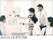 Купить «business team working with flipchart in office», фото № 6473768, снято 9 июня 2013 г. (c) Syda Productions / Фотобанк Лори