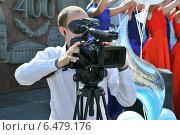 Видеооператор (2014 год). Редакционное фото, фотограф Роман Палтахиенти / Фотобанк Лори