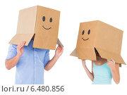 Купить «Couple wearing emoticon face boxes on their heads», фото № 6480856, снято 29 апреля 2014 г. (c) Wavebreak Media / Фотобанк Лори