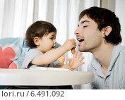 Купить «Father playing with baby in the living room», фото № 6491092, снято 18 января 2019 г. (c) BE&W Photo / Фотобанк Лори
